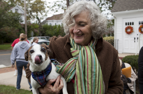 Gail Horton and her dog Sparky wait their turn for a blessing in 2012. (Credit: Katharine Schroeder, file)