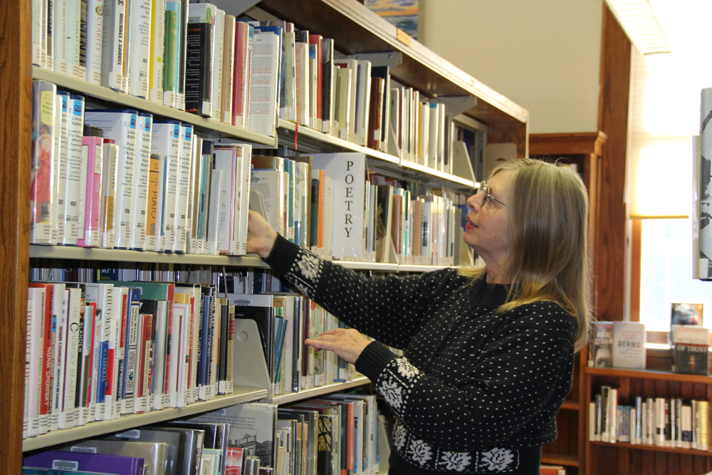 Poppy Johnson has spent the past 18 months reorganizing books by topic. (Credit: Carrie Miller)