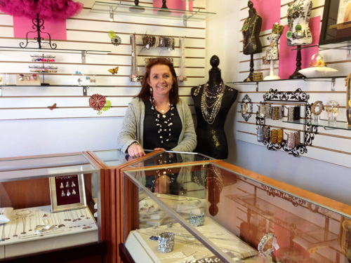 RACHEL YOUNG PHOTO | Glitzee Gal Creations owner Linda Stavrinos at her Mattituck shop.