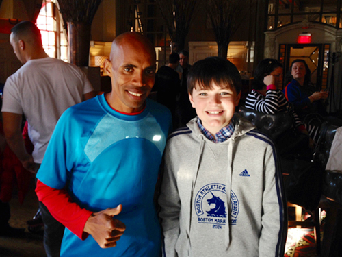 Meb Keflezighi, winner of the Boston Marathon, the night before his historic victory with Liam Adipietro of Shelter Island. (Credit: courtesy)