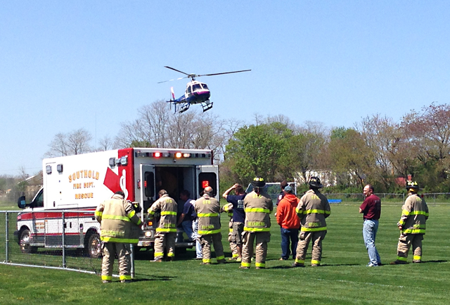 A Suffolk County Police helicopter lands at Cochran Park in Peconic Thursday. (Credit: Joe Werkmeister)
