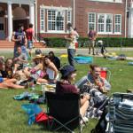 Seniors relaxing outside as part of a senior prank.