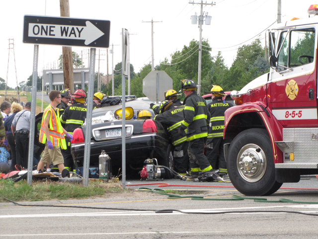 Fire crews on scene of Saturday's accident. (Credit: Tim Gannon)