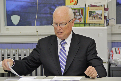 New Suffolk Common School board president Tony Dill presenting his preliminary spending plan during Tuesday night's regularly scheduled board meeting. (Credit: Carrie Miller)