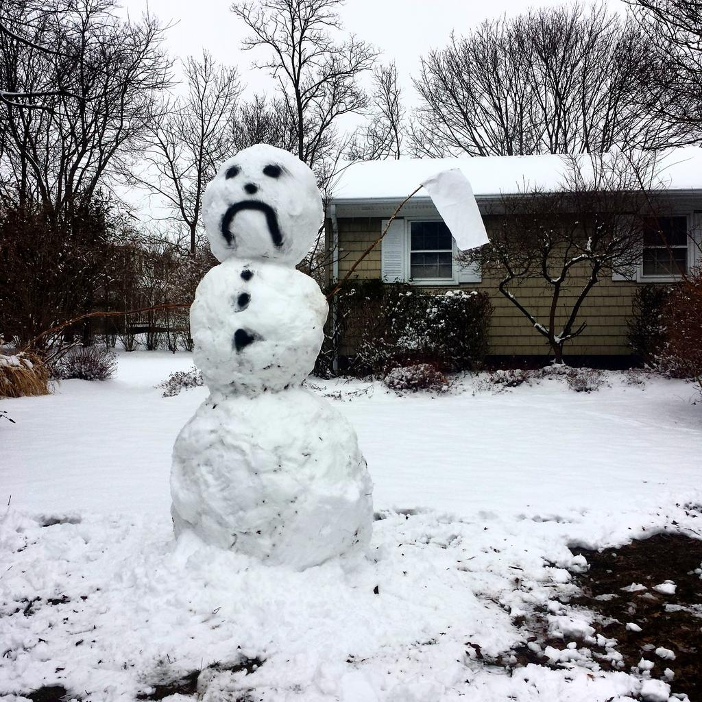 A snowman waves the white flag in Greenport. (Credit: Ryan Malone)