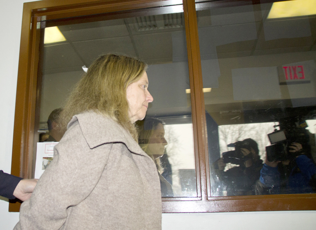 Diane O'Neill of Farmingville is led into Riverhead Town Court last month following a fatal accident in Jamesport. (Credit: Paul Squire, file)