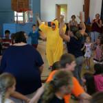 Ms. Wissemann leading the school in a chicken dance.