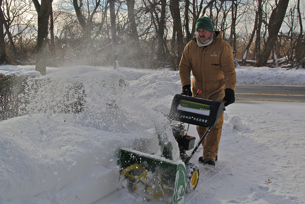 Joseph Henry of Greenport and his money maker, a John Deere snow blower.