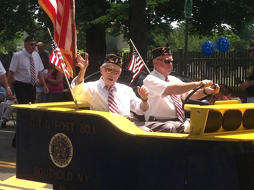 The 2013 Southold Village Merchants Fourth of July Parade featured plenty of sunshine. This year it has been postponed a day due to rain. (Credit: Cyndi Murray, file)