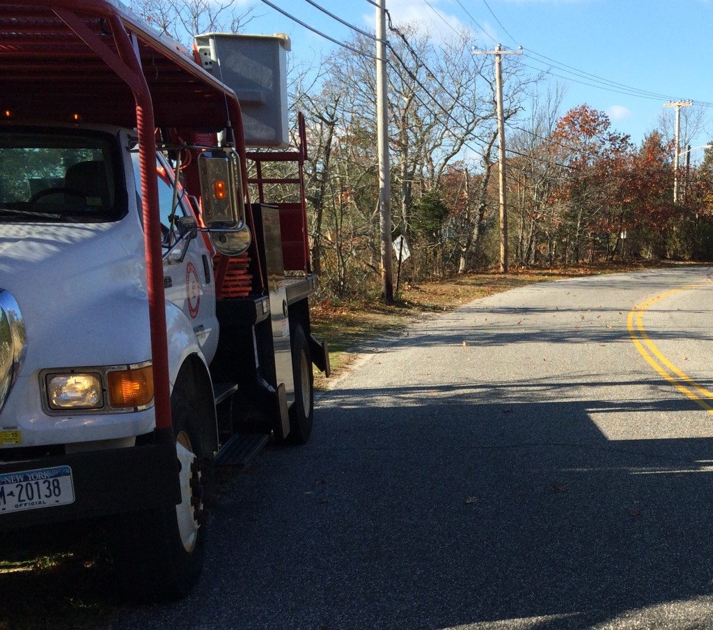 A Southold Town highway crew arrives at the site of the accident at 11 a.m. Tuesday. (Credit: Grant Parpan)