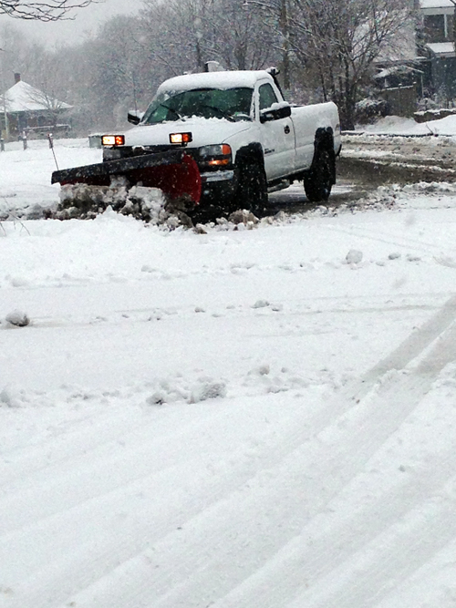 A snow plow makes its way through Greenport Village.
