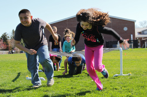 Southold Elementary School fifth graders Ronald Gonzalez and Danielle Henry make the obstacle course look easy. (Credit: Carrie Miller)