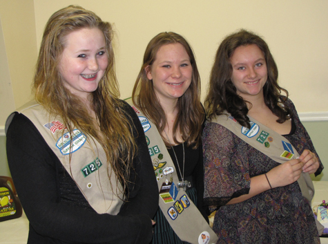 Sarah Fogarty (from left), Emily Gatz and Samantha Kaelin, members of Cadette Troop 725 of Southold, were awarded the Silver Award, Girl Scouting's second highest award, in a ceremony held Jan. 22 at the Southold Town Recreation Center. The scouts were honored for their 'Dog Park Party 2011' project, for which they ran monthly themed gatherings for dogs and their owners at the town dog park on Peconic Lane.