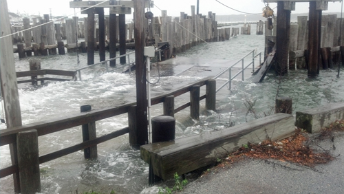 PAUL SQUIRE FILE PHOTO | North Ferry in Greenport during Superstorm Sandy.