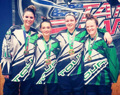 Sarah Sinning of Peconic, second from left, pictured after helping lead her roller hockey team, Tour Roadrunners to a tournament win in Detroit last April. (Courtesy photo)