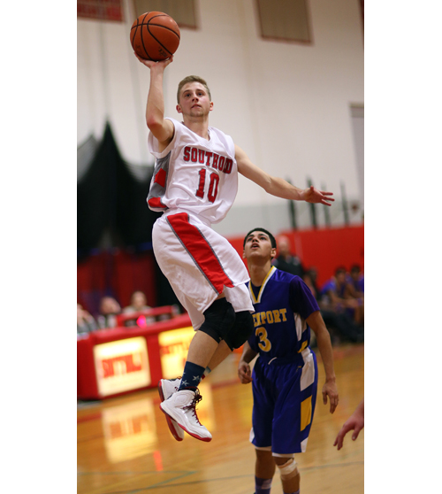 Southold guard Shayne Johnson goes up for a one-handed shot Thursday against Greenport. (Credit: Garret Meade)