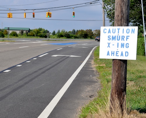 A prankster erected a smurf crossing sign after blue paint split on the roadway. (Credit: Cyndi Murrayphoto)