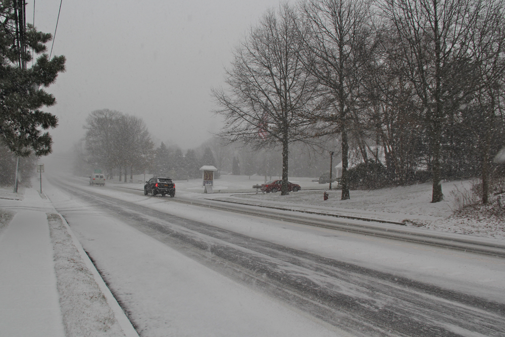 Snow blankets the Main Road in Mattituck. (Credit: Carrie Miller)