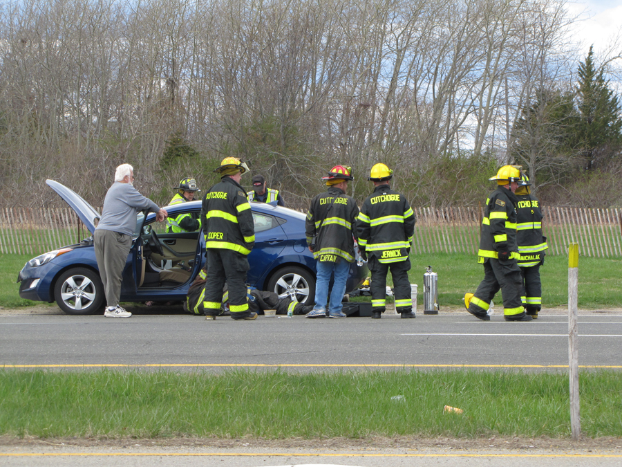 Firefighters expect the car that was leaking fluid on the road just west of Cox Lane on Route 48. (Credit: Tim Gannon)