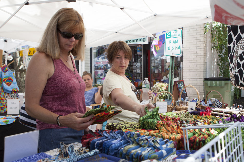 Debbie DeLuca, left, and Linda DiRienzo, both of Branford, Conn., shopping for trinkets. (Credit: Katharine Schroeder)