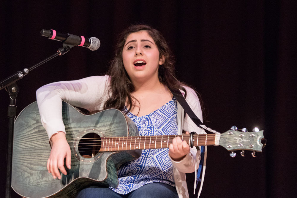 "Alexa Palumbo performs her original composition ""Gone."" (Credit: Katharine Schroeder)"
