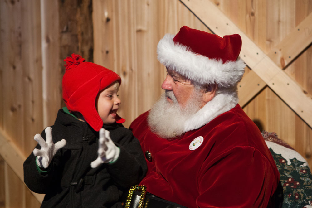 Three-year-old Evan Ford of Southold tells Santa all his Christmas wishes.