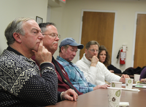 CARRIE MILLER PHOTO | Southold Town Trustees Michael Domino, John Bredemeyer, Jim King, and Charles Sanders listen as the Southampton Town Trustees' attorney discusses the injunction.