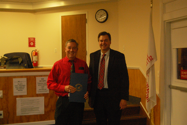 Dave Bergen (left) and Suffolk County Legislator Al Krupski after Mr. Bergen received his proclamation for his ten years of service as a Southold Town Trustee (Credit: Nicole Smith).
