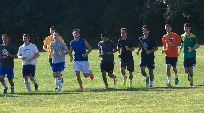 Mattituck players loosen up during Monday morning's practice in Aldrich Lane. (Credit: Garret Meade)